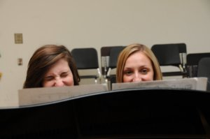 Abby and Jennifer behind music stand