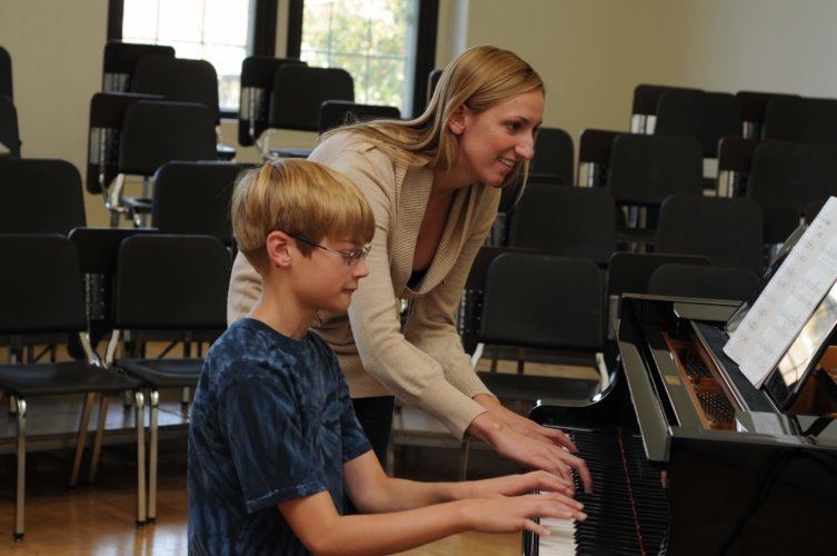 Jennifer teaching Aiden at the piano