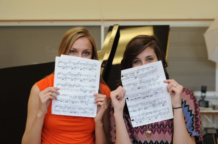 Jennifer and Abigail holding sheet music