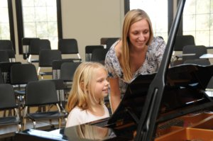 Jennifer teaching Olivia at the piano