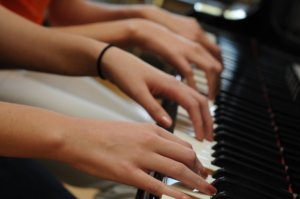 Hands on the piano keys